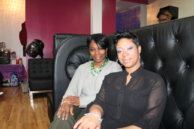 <p>Stephanie McGraw founder of W.A.R.M. (left) has partnered with Elita Spence-Bowles, owner of Elite Conception Hair Lounge to bring women facing domestic abuse to the shop on West 144th Street between Frederick Douglass Boulevard and Adam Clayton Powell Jr. Boulevard for a day of treatment.</p>