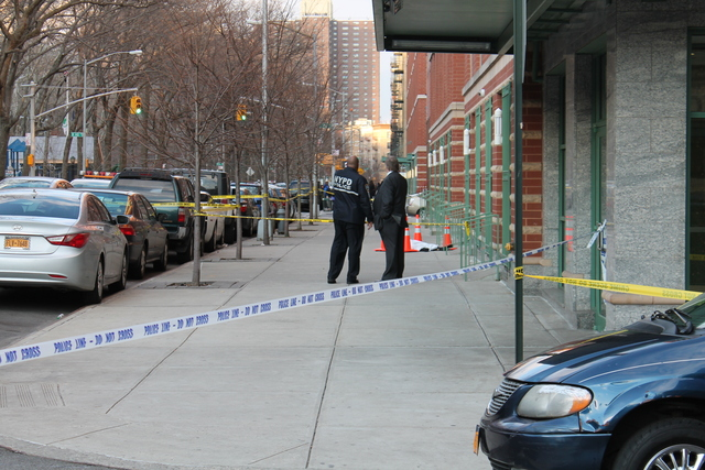 <p>Police gathered outside of the building on Bradhurst Avenue and 147th Street where a 45-year-old woman plunged to her death while cradling her 10-month-old&nbsp; baby.</p>