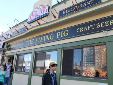 The Flying Pig is slated to open on Tuesday, April 30, at 70-28 Austin St., where a Johnny Rockets restaurant had previously been located.