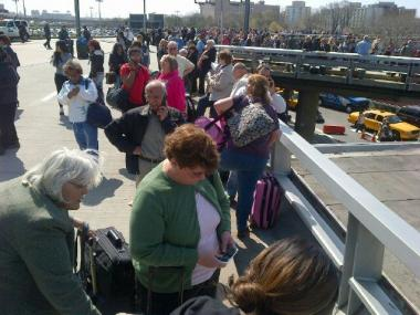 Reports of a suspicious package prompted a massive evacuation at LaGuardia Airport Tuesday morning, reports said.
