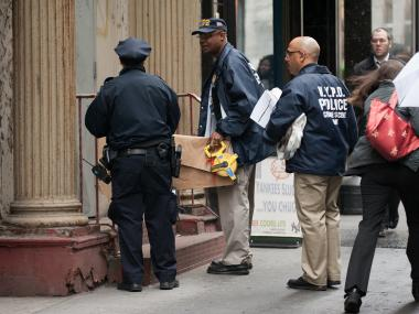 MANHATTAN - Officials from various city agencies are seen at 51 Park Place, as they investigate the finding of part of a Boeing  aircraft from the 911 attacks.