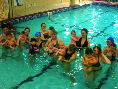 During the classes offered by Take Me to The Water Swim School, kids learn their first swimming skills, including breath control, arm movements and leg kicks.