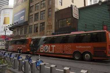 Midtown businesses urged the city's Department of Transportation to move bus stops for private carriers after passengers clogged sidewalks.