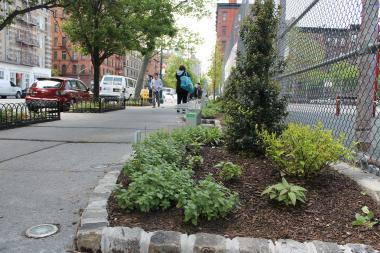 The streetscape has new benches and plants to try to create a welcoming area on an underutilized block.