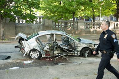 A woman died after a Nissan Altima sedan crashed on the Brooklyn side of the Williamsburg Bridge.