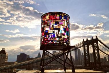 Tom Fruin's watertower, made of salvaged plexiglas and steel, has become a symbol of DUMBO arts and culture.