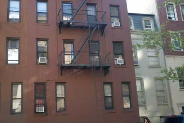 The woman fell down the open shaft within an East 82nd Street building, FDNY said.