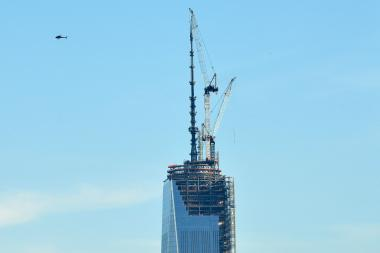 Workers secured the spire atop One World Trade Center Friday morning, making the structure the tallest in the U.S.