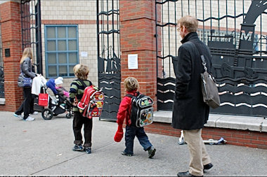 Students and parents head into TriBeCa's P.S. 234 in November.