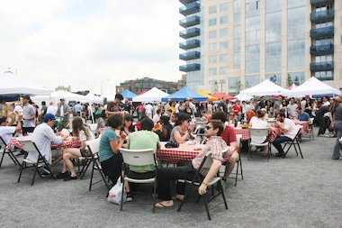 People enjoy food from a variety of vendors at Smorgasburg in the East River Park in Williamsburg. The food market and Brooklyn Flea will start their outdoor season on April 5.