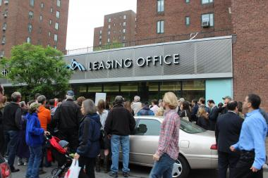 At least a hundred tenants attended a press conference on May 15, 2013, to oppose mid-lease rent increases by CW Capital.