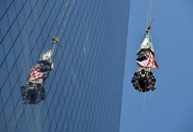 The final peices of the WTC spire were hoisted to the top of the high-rise Thursday.
