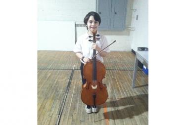 Asher Kalfus, 9, will perform on the cello at the concert in St. Paul's Church, June 30.