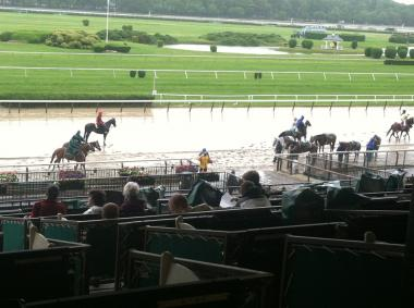 The rainy conditions Friday at Belmont Park were expected to stretch into Saturday's 145th running of the Belmont Stakes.