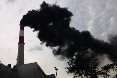 Big Allis, a well-known smokestack in the Long Island City area, pours black smoke after a fan breakdown on June 24, 2013.