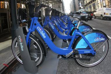A woman on a Citi Bike was clipped by a car at Broadway and Grand Street on Wednesday.