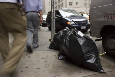 "Residents and business owners say West 56th Street has turned into a ""garbage minefield."""