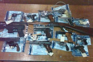 Weapons turned in during a gun buyback organized in Jamaica last year.