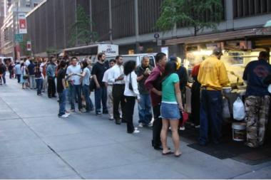 The Halal Guys food cart draws long lines of customers.