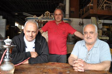 The Salameh brothers operate Mona Liza Fine Furniture and own Paper Box and Shea Stadium venues on their block.