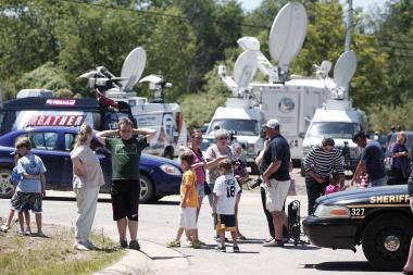 Onlookers gather at the site where FBI agents search a field for the alleged remains of former Teamsters' union president Jimmy Hoffa on June 17, 2013 in Oakland Township, Michigan. The agents were acting on a tip provided by Tony Zerilli, 85, a former mobster, who was released from prison in 2008. Hoffa, who had reported ties to organized crime, went missing in July of 1975.