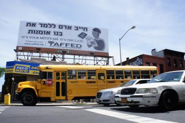 Education advocates hope this black and white billboard in Brooklyn will catch the eye of parents in the borough's large Orthodox Jewish community, where more than 84,000 students attend religious schools, many of which do not meet legal minimum requirements for instruction in English, science and math.