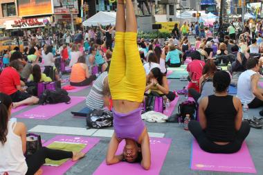 Thousands of yoga enthusiasts took part in a solstice celebration in Times Square on Friday, June 21, 2013.