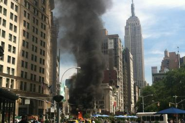 A van in the Flatiron burts into flames Wednesday morning.
