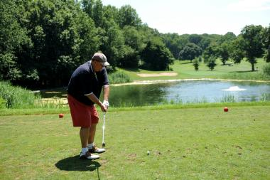 Brandon McGovern tees off on the 15th hole at Forest Park Golf Course.