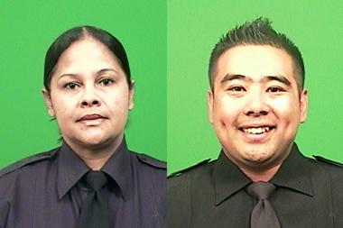 Police officers Annette Lancaster and Eddie Wong rescued two from a Gravesend car crash, cops said.