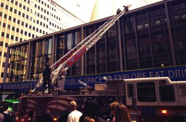 Firefighters combat a blaze on the roof of the Fulton Center transit hub, July 15, 2013.