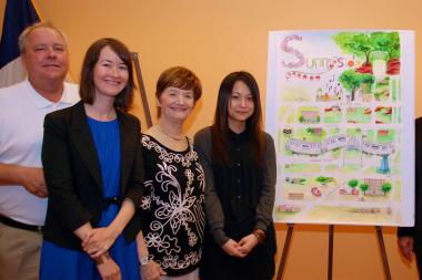 LaGuardia Community College student Carmen Zhu with her winning Sunnyside map design.