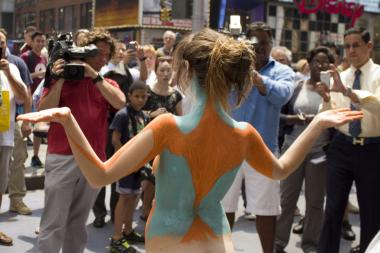 Artist Andy Golub painted nude models Gianna James and Ethan Itzkow in Times Square on Wednesday afternoon, July 10, 2013.