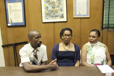 John Flanagan, Heather Hightower and Lisa-Erika James (L-R) say their principal targeted them because of their race.