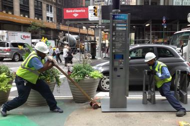 The city's  Department of Transportation  relocated a  Citi Bike  stand on Broadway Friday morning, July 12, 2013, shifting it several feet uptown from just north of 57th Street to just south of 58th Street.