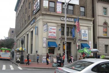 A local group successfully fought to remove ads from a buidling on Jamaica Avenue.