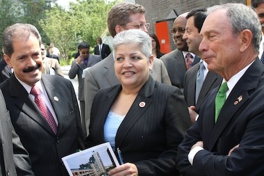 City Councilwoman Maria del Carmen Arroyo with Rep. José Serrano and Mayor Michael Bloomberg at an event in her district in 2012. Three former Arroyo reelection campaign workers were charged with fraud Wednesday.