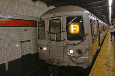 Three women threw a substance into the face of a straphanger and then robbed her, police said.