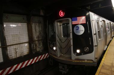 A woman survived after at least one train ran over her in Midtown, officials said.