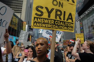 Obama's announcement urging a military strike on Syria sparks hundreds to gather in Times Square to protest military intervention on Saturday, August 31, 2013.