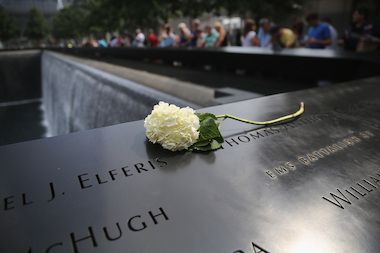 A flower lies atop names of victims at the 9/11 Memorial on Sept. 10, 2013. The 9/11 Museum will open to the public May 21, 2014.