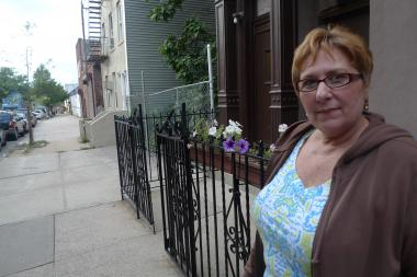 President Street neighbors say the city is trying to 'force the garden down their throats.'