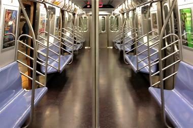 A man sleeping on a Downtown E train awoke Sept. 22, 2013 to find a woman lying under his seat, trying to steal his phone, police said.