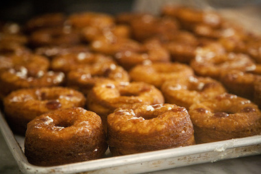 A tray of fresh Cronuts being prepared at Dominique Ansel Bakery.