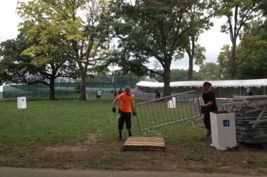 The tents and stages at Randall's Island were being torn down early Sunday, after the city and promoters canceled the dance festival.