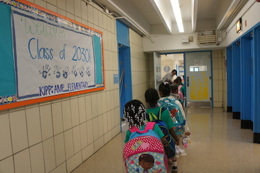 Kindergarteners walk to class at KIPP AMP Elementary School in Crown Heights. The brand new school is one of three charter elementaries opening in Brooklyn's District 17 for fall 2013, making Crown Heights one of the city's most charter-dense neighborhoods.