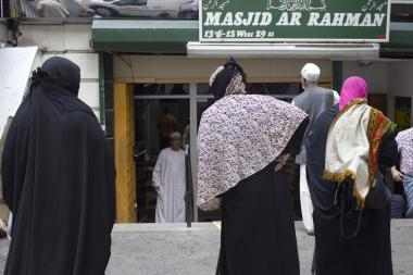 "Seven women cloaked head-to-toe in traditional Islamic garb sought donations outside a mosque on West 29th Street in Midtown on Friday, Aug. 30, 2013. Some claimed to be collecting donations for an ""Islamic charity."""