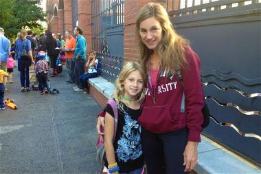 Greenwich Street was crowded with families headed back to school at P.S. 234 on September 9, 203.