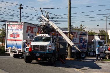 A tractor-trailer crashed into two utility poles on Monday morning, knocking out power for 964 Staten Island residents, a Con Edison spokesman said.