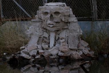 The cinderblock sculpture was taken by men with a moving truck, witnesses said.